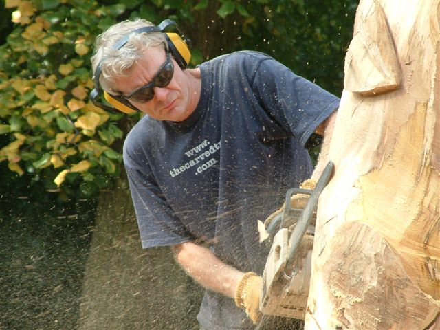 Paul Sivell in action sculpting a tree